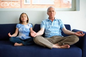 Grandfather and Girl in Lotus Posture on Couch